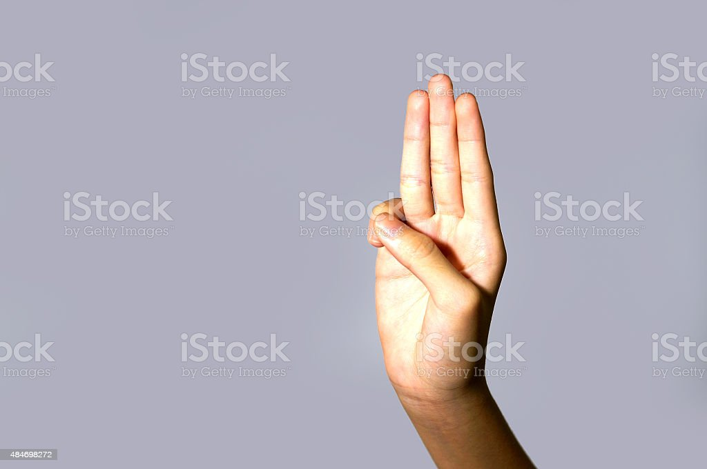 Scout honor hand gesture stock photo