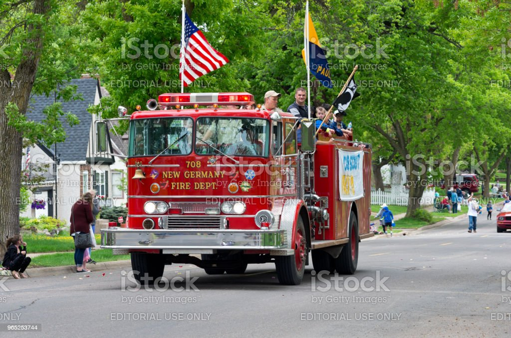 Scouts Aboard Fire Engine at Parade stock photo