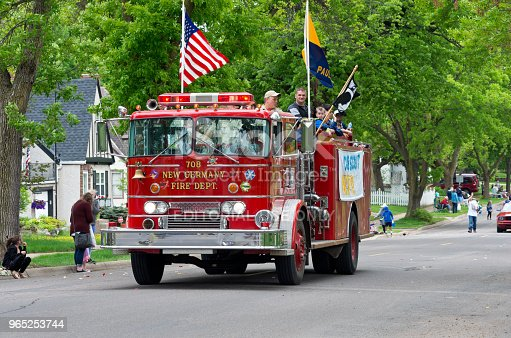 Scouts Aboard Fire Engine At Parade Stock Photo & More Pictures of Adult
