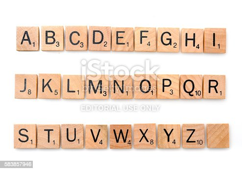 Miami, Florida, USA - December 7, 2015: Scrabble game board Lettered wooden tiles complete alphabet on white background. Scrabble is a fun and educational game distributed by Hasbro