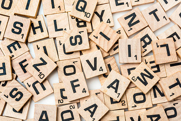 scrabble letters - word game stock pictures, royalty-free photos & images