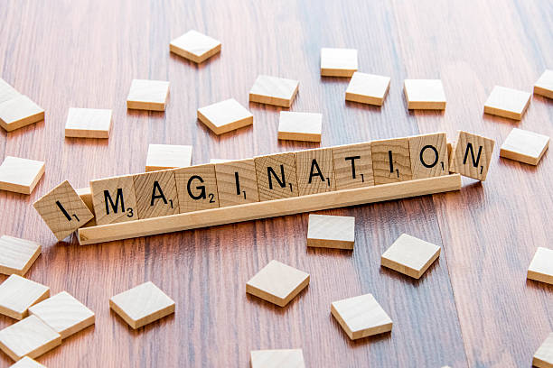Scrabble Word Game wood tiles spelling IMAGINATION stock photo