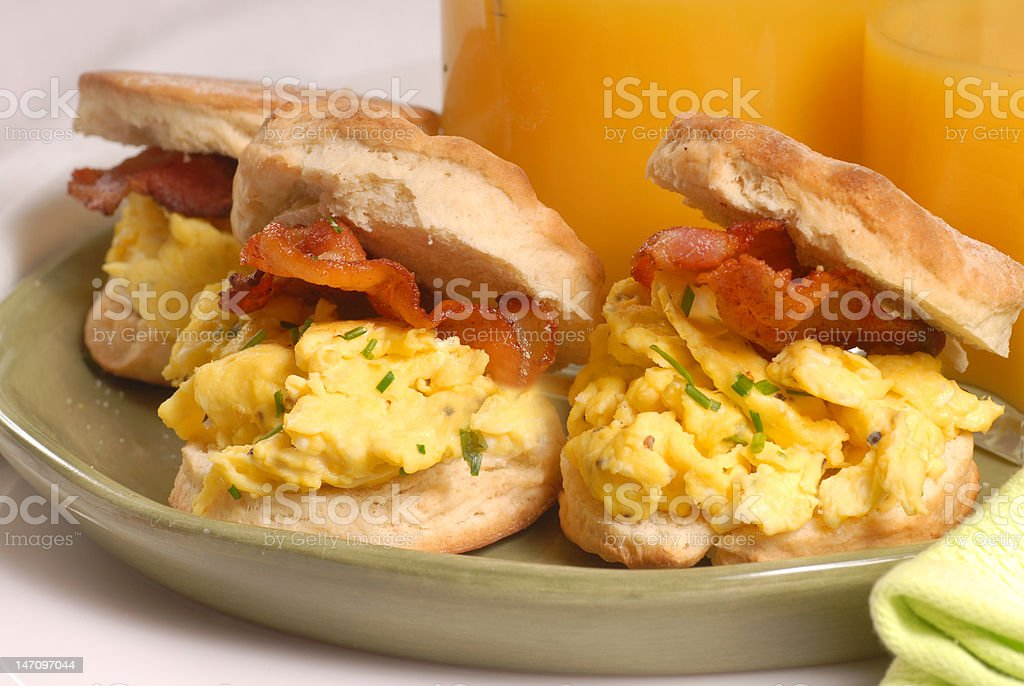 Scrambled egg and bacon biscuit stock photo