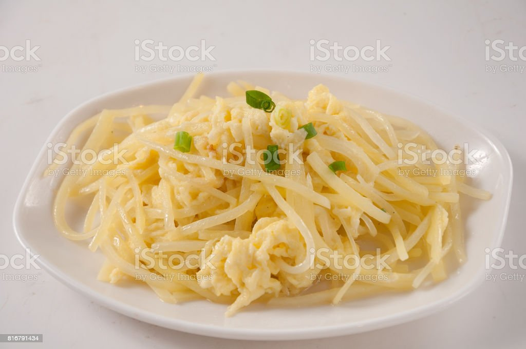 Scrambled egg with shredded potatoes stock photo