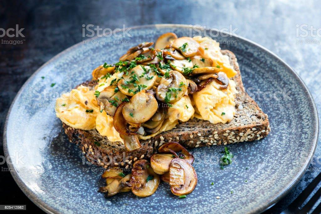 Scrambled Eggs and Mushrooms on Toast stock photo