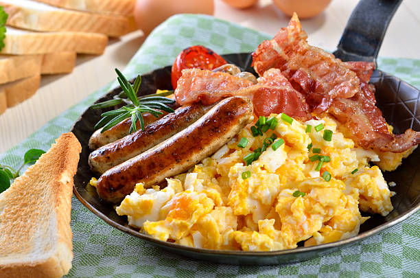 scrambled eggs and sausages - breakfast stock photos and pictures