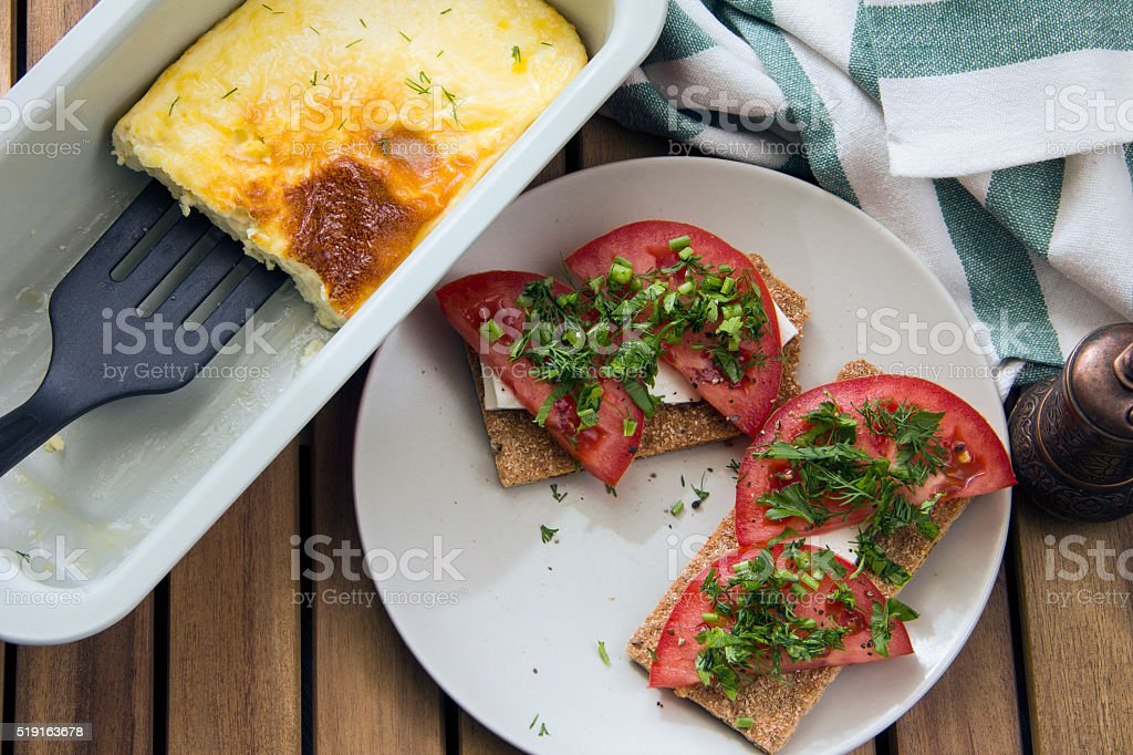 Scrambled eggs and tomato, cheese, parsley served on toast bread stock photo