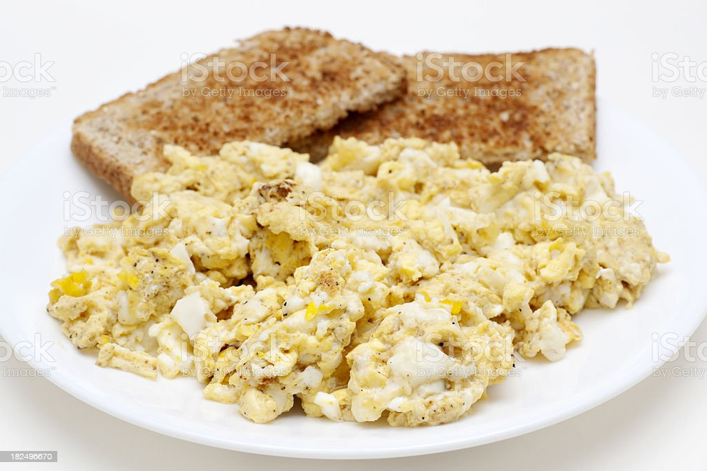 Scrambled Eggs And Whole Wheat Toast Royalty Free Stock Photo