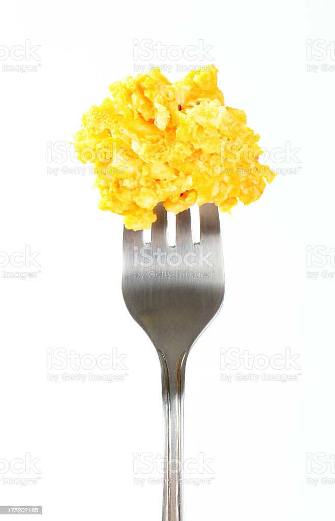 Scrambled eggs on a fork stock photo