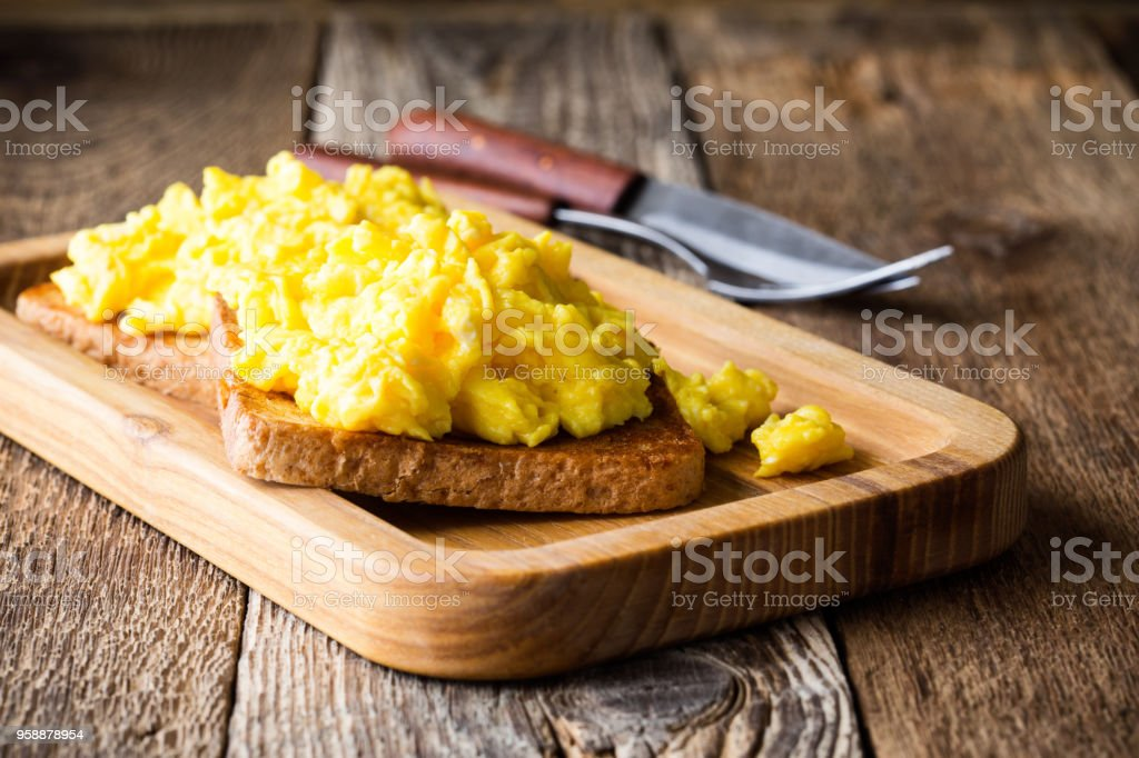 Scrambled eggs on two pieces of toast stock photo
