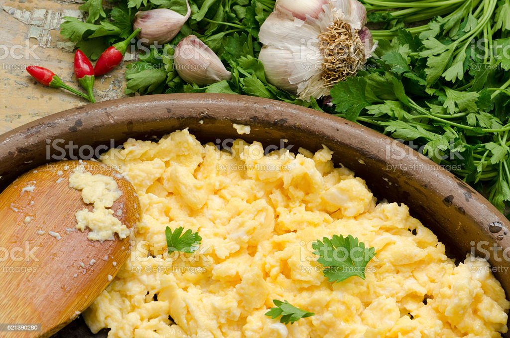 Scrambled eggs with garlic and parsley stock photo