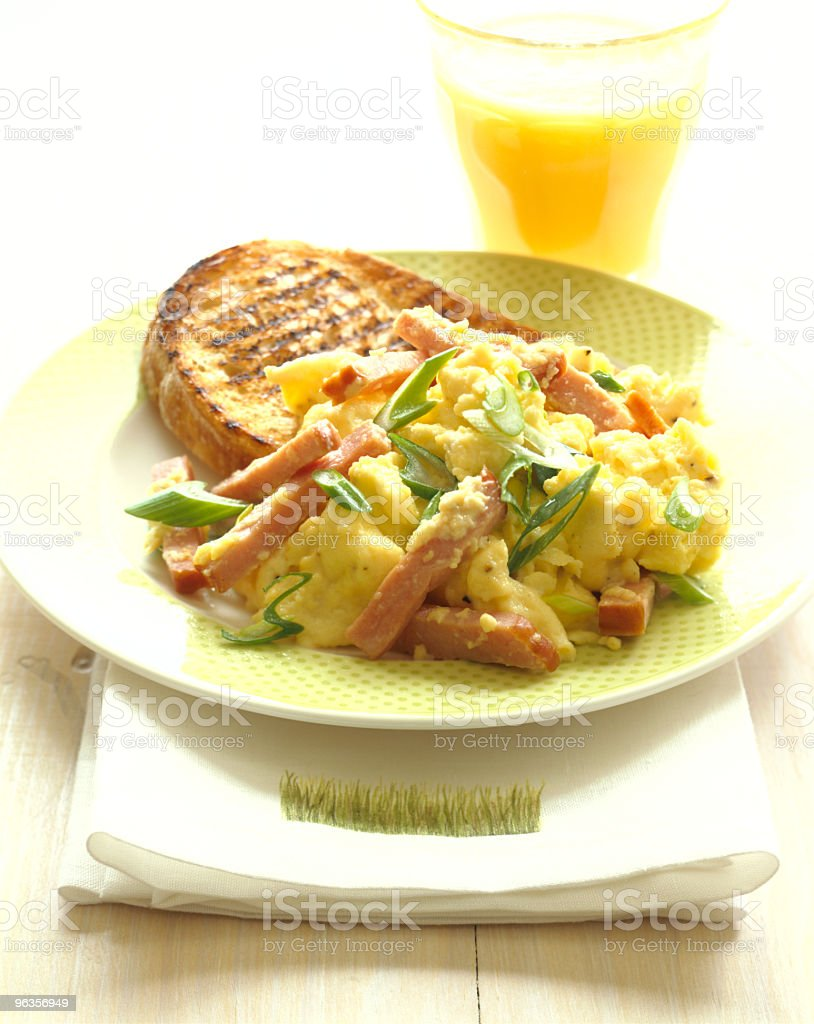 Scrambled Eggs with Orange juice and toast. royalty-free stock photo