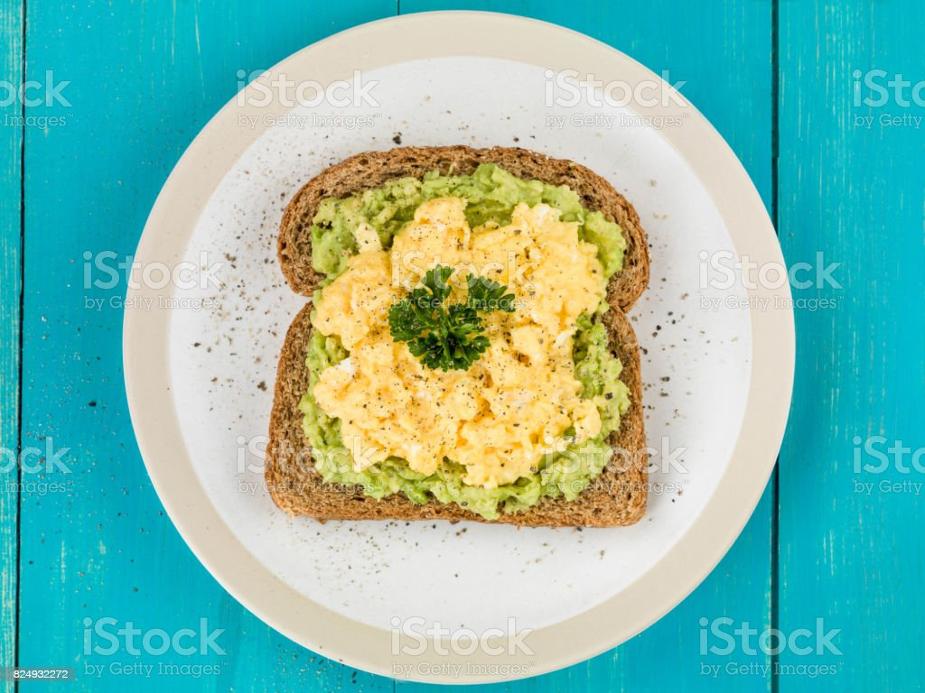 Scrambles Eggs and Avocado on Toasted Wholemeal Bread stock photo