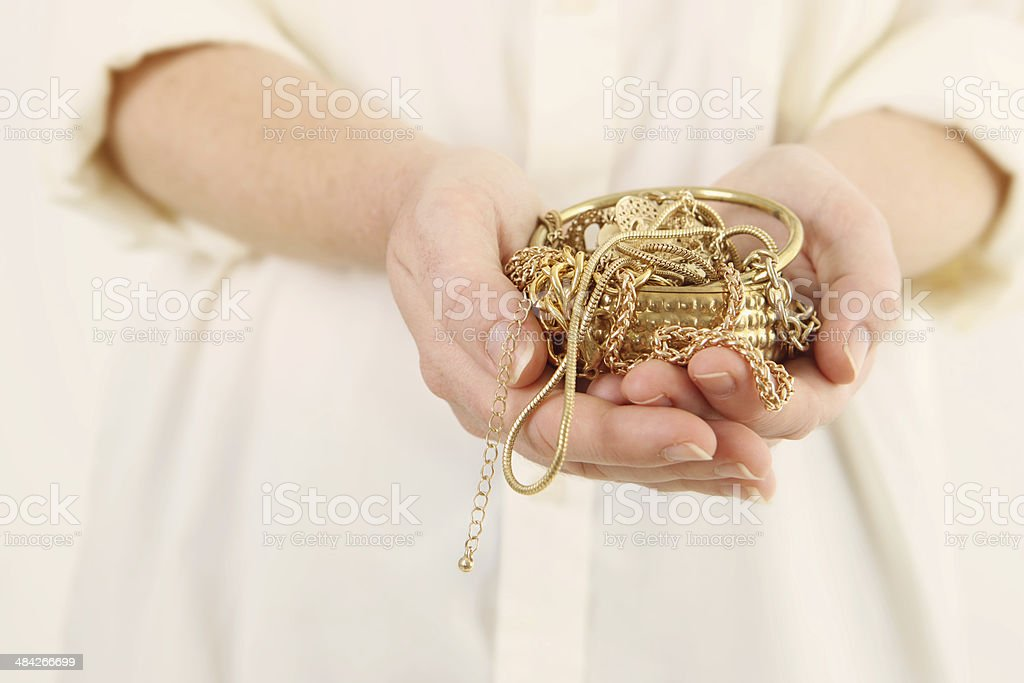 Scrap Gold in hands stock photo