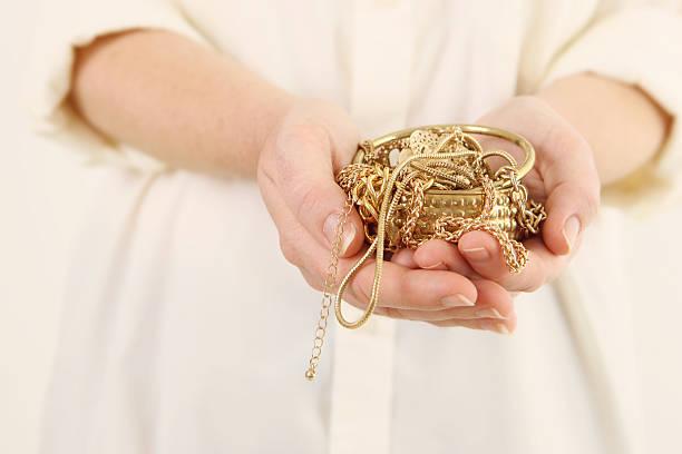 scrap gold in hands - hand gold jewels bildbanksfoton och bilder