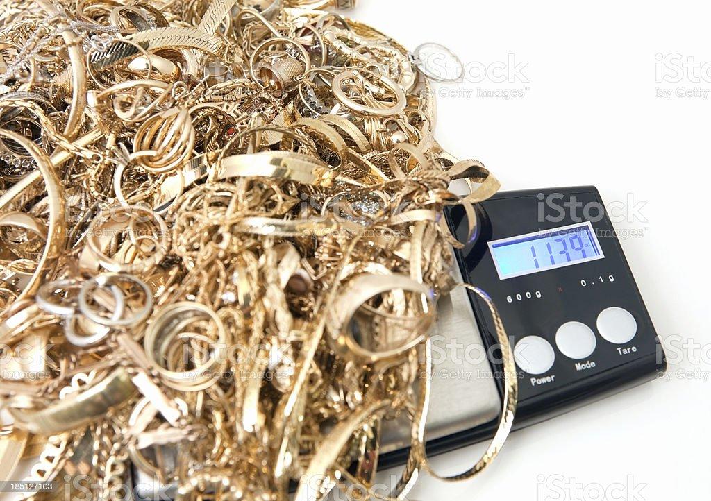 Scrap Gold on Jeweler's Scale stock photo