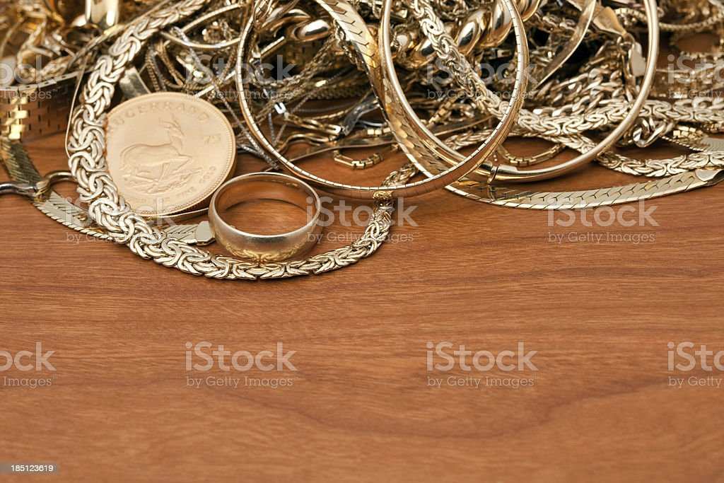 Scrap Gold Pile On Cherry Wood stock photo