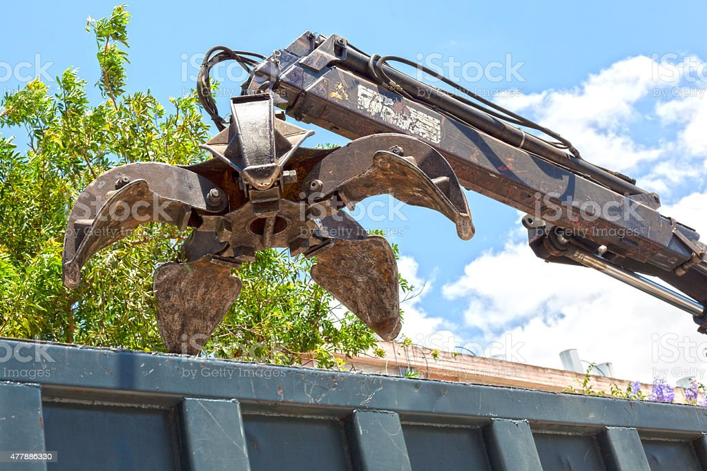 Scrap grab overhanging the lorry stock photo