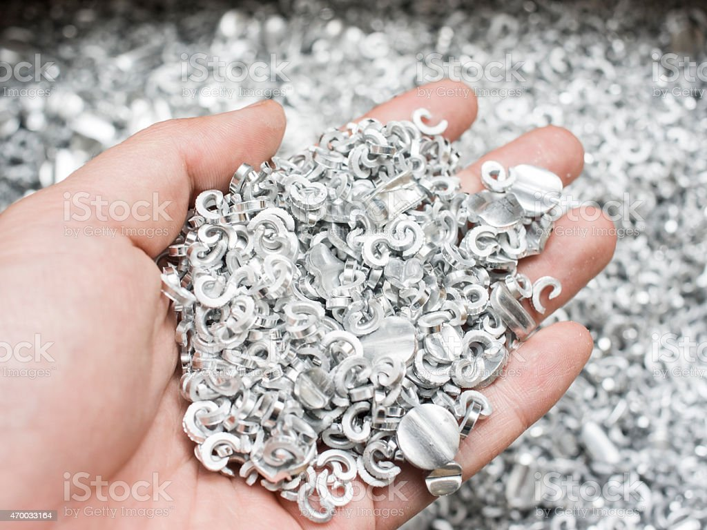 Scrap metal aluminum in hand stock photo