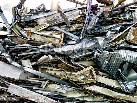 Scrap, metal and aluminium pressed together i a pile of metal junk