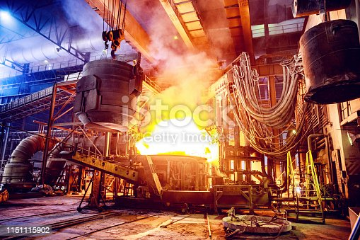Steel, Factory, Business, Industry, Africa - Scrap metal being poured into an Electric Arc Furnace