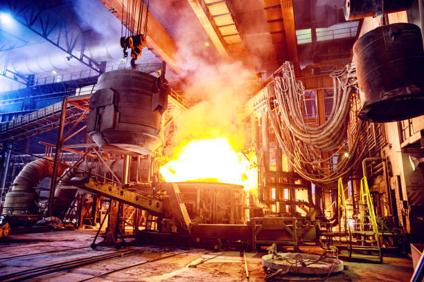 Scrap metal being poured into an Electric Arc Furnace at a Steel Factory stock photo
