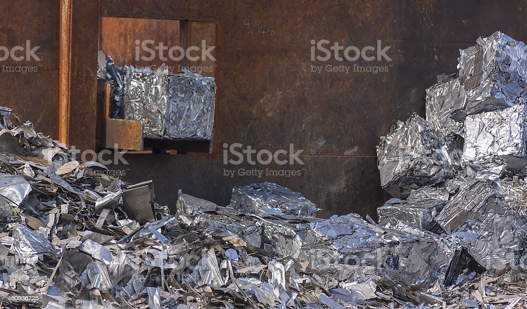 Scrap metal being processed into cubes royalty-free stock photo