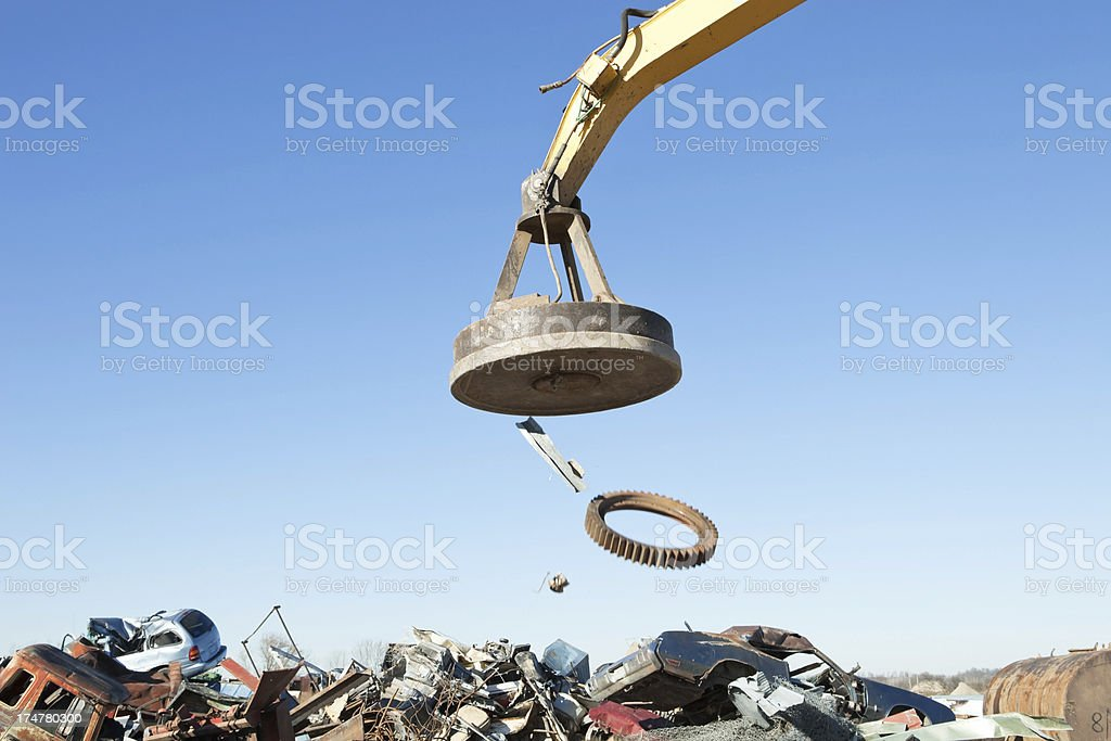 Scrap Metal Falling from a Salvage Yard Magnet stock photo