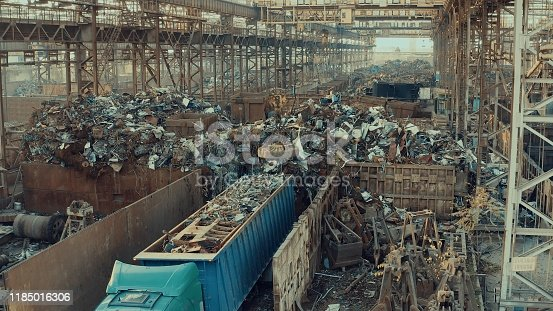 Scrap metal for recycling at a steel mill - magnetic crane