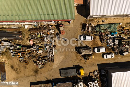 Scrap metal junkyard area aerial view. Reception and storage metal waste before recycling