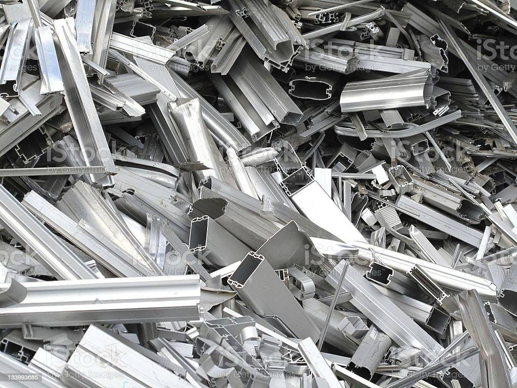 Scrap metal pieces laying in a pile stock photo