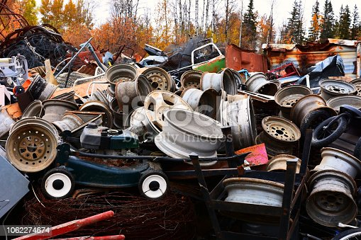 An image of a huge pile of scrap metal at a recycling facility.