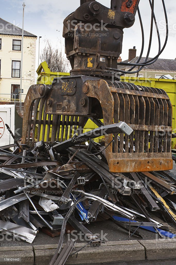 scrap metal with grappler royalty-free stock photo