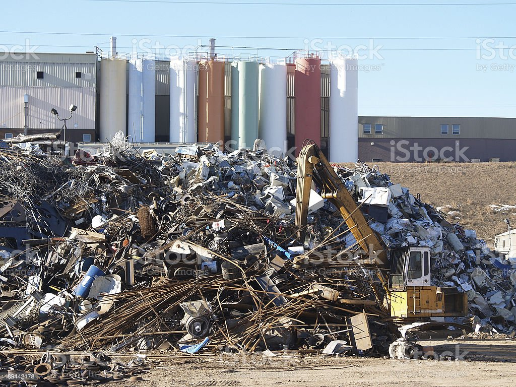 Scrap Metal Yard With Tractor royalty-free stock photo