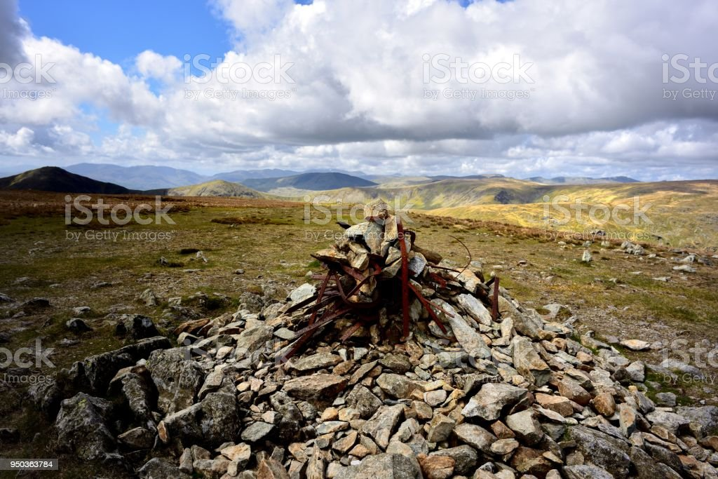 Scrap rusty metal in the cairn on Harter Fell stock photo