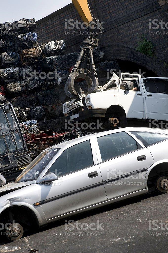 Scrap yard and crane royalty-free stock photo