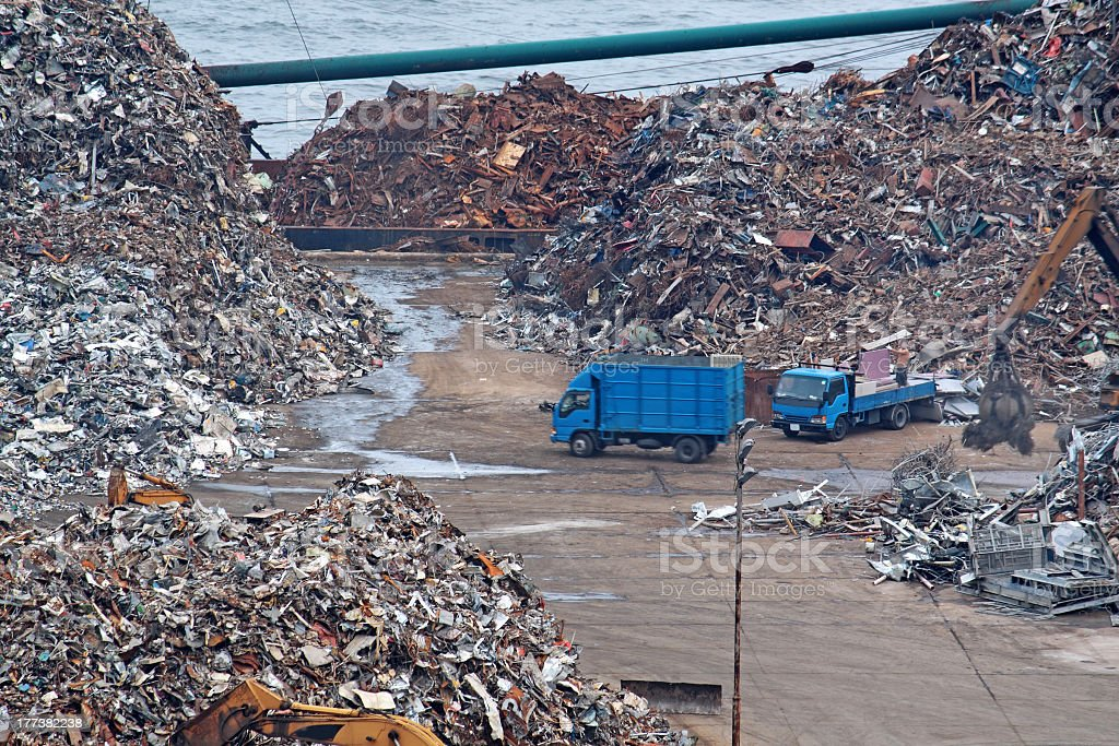 Scrap yard recycling with blue truck royalty-free stock photo
