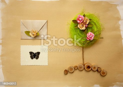 678159134 istock photo Scrapbook page w elvelope, old photo and flower tree 180343012