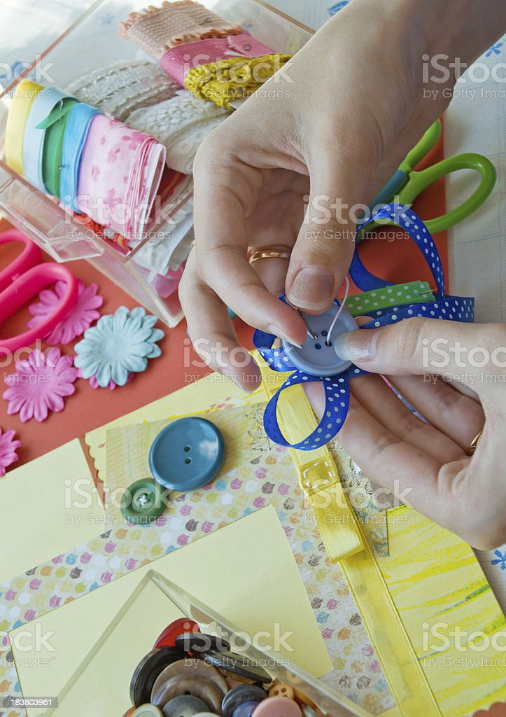 Scrapbooker's hands stock photo