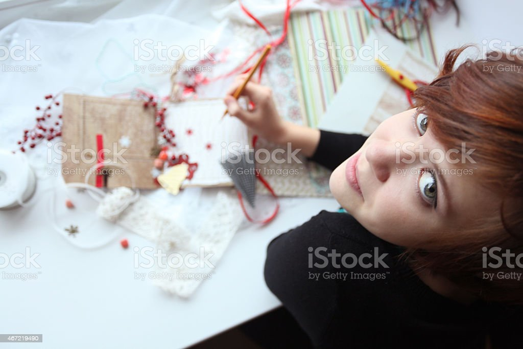 scrapbooking girl working stock photo
