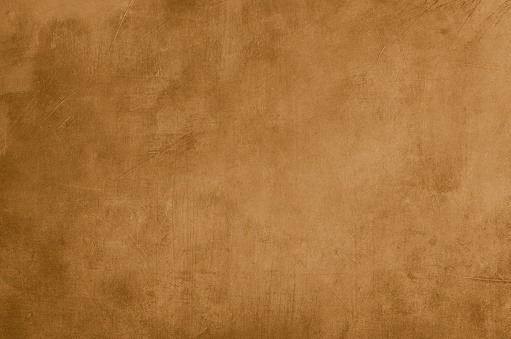 Ochre grungy wall backdrop or texture