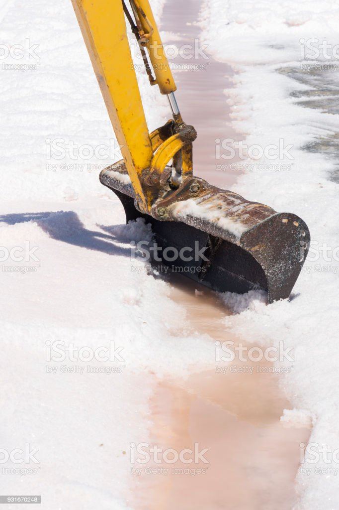 scraper at work at saltworks of Trapani in Sicily stock photo