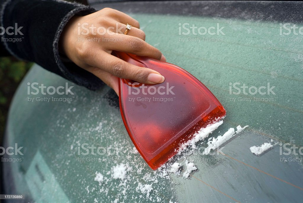 scraping a Frozen windscreen royalty-free stock photo