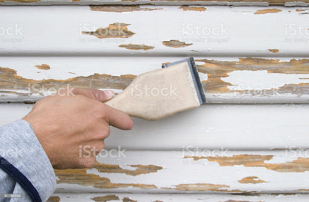 Scraping before paint stock photo
