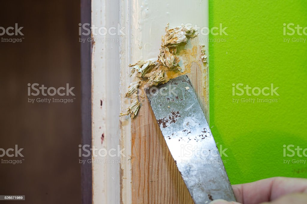 Scraping Off Paint stock photo