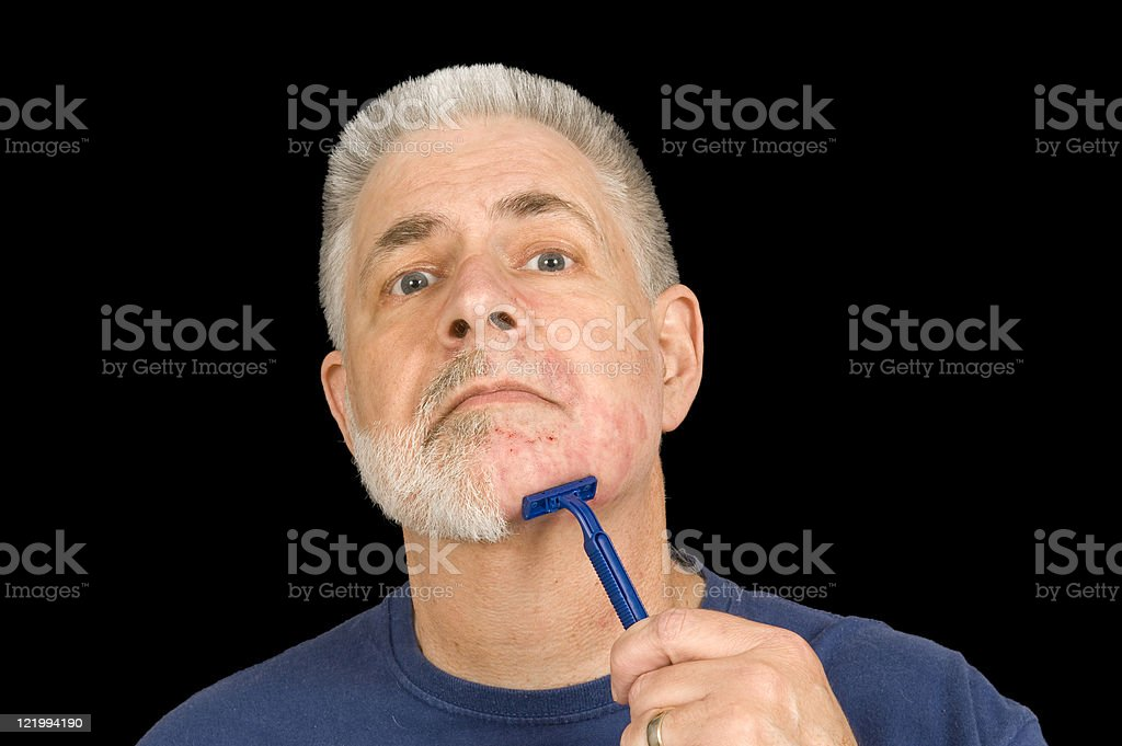 Scraping Off The Beard stock photo