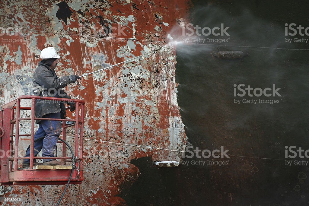 scraping surface before painting ship stock photo