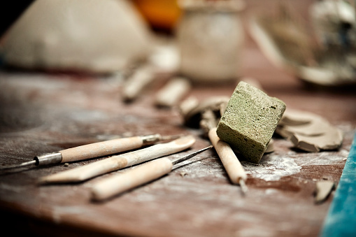 Scraping tools and sponge in pottery workshop