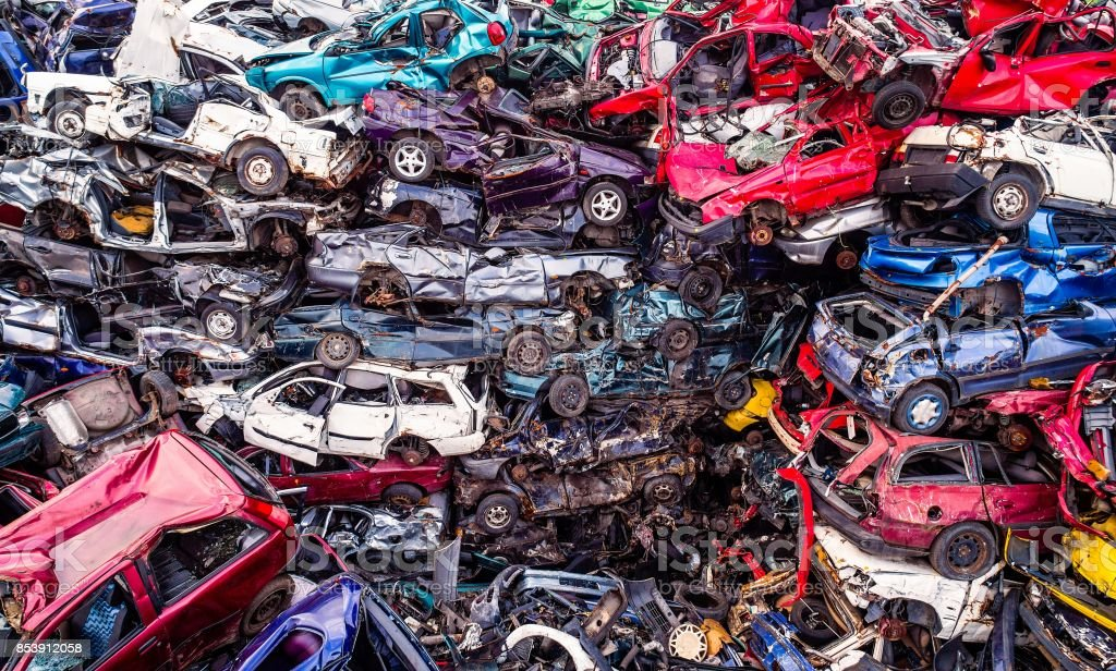 Scrapped cars stacked on a scrap yard. stock photo