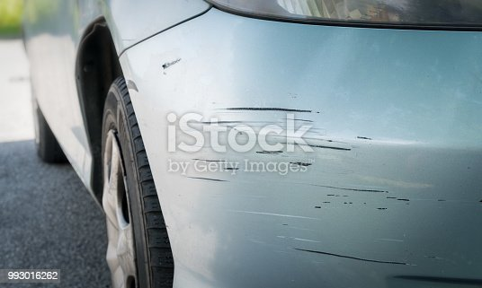 Scratched car with deep damage to the paint